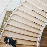 Buy cheap Dark color steel double stringer curved stairs / curved wood stairs from wholesalers