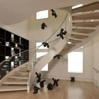 Buy cheap High safety unique design Curved stairs with modem solid wood tread and glass railing balustrade product