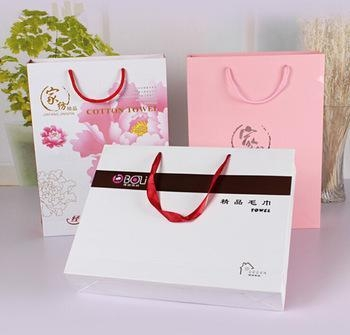 Quality White matt gift paper bags with black hot foil stamping for sale