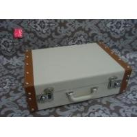 White decorative vintage leather suitcase with metal lock